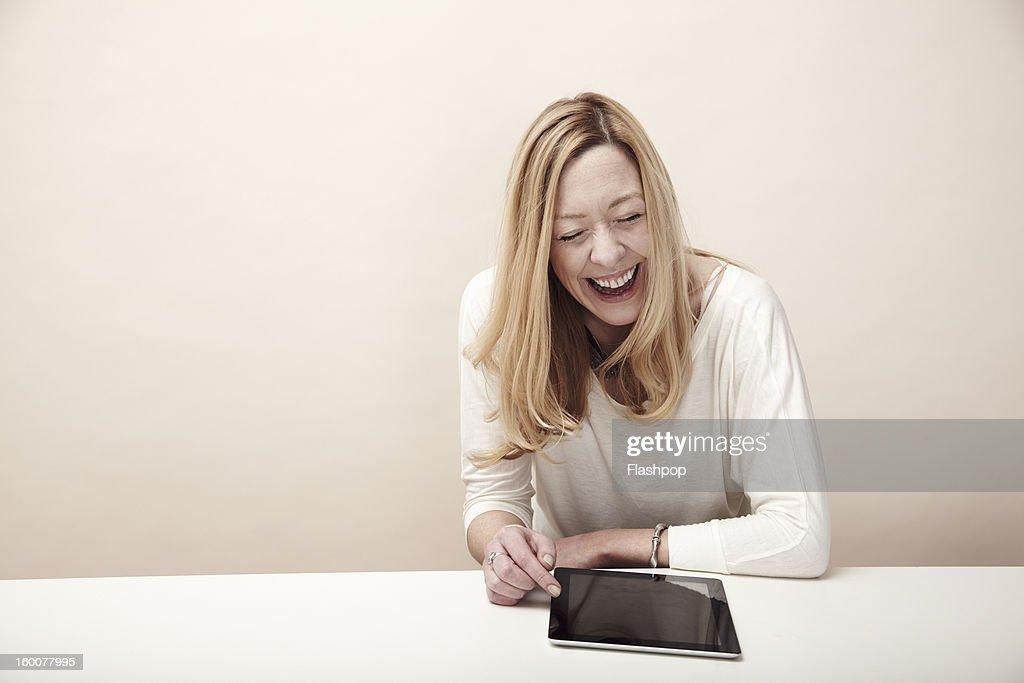 Woman using digital tablet : Bildbanksbilder