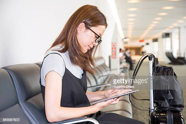 Woman using digital tablet