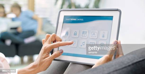 woman using digital tablet - mid section stock photos and pictures