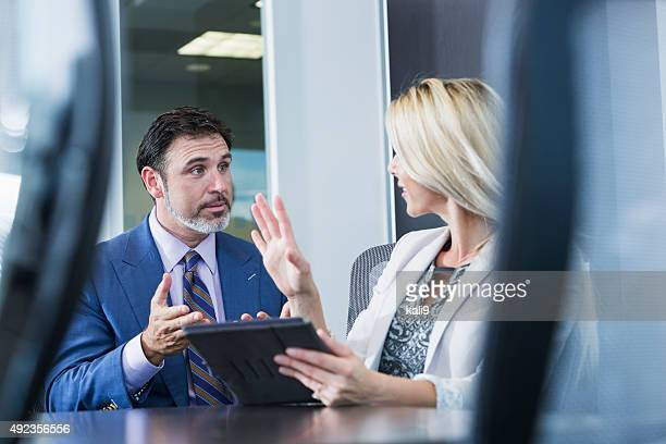 Woman using digtal tablet in business meeting