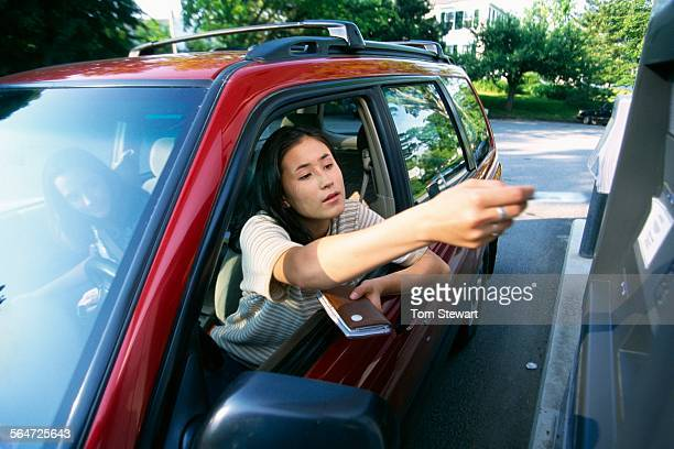 Woman Using Drive Through ATM