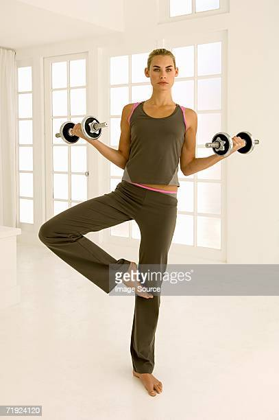 woman using dumbbells - tracksuit bottoms stock pictures, royalty-free photos & images