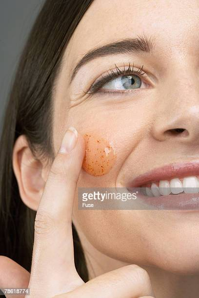 Woman Using Facial Scrub
