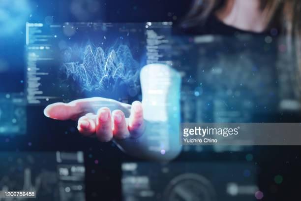 woman using futuristic digital interface display - デジタルディスプレイ ストックフォトと画像