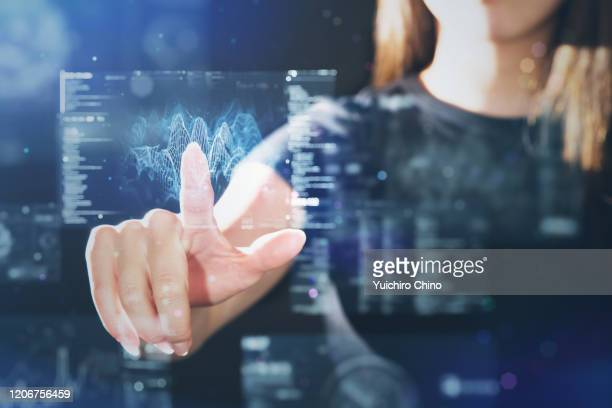 woman using futuristic digital interface display - big data screen stock pictures, royalty-free photos & images