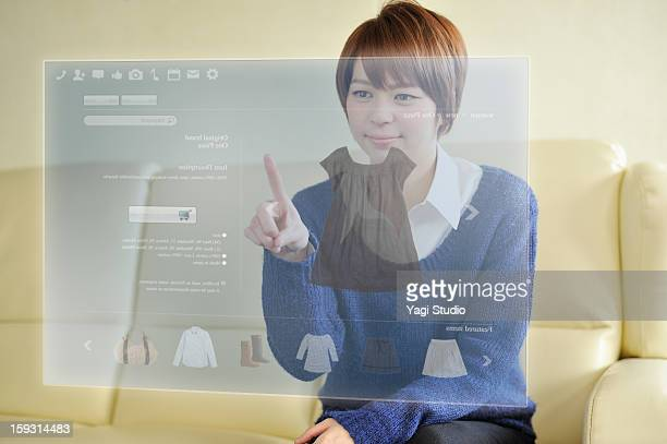 Woman using Futuristic monitor
