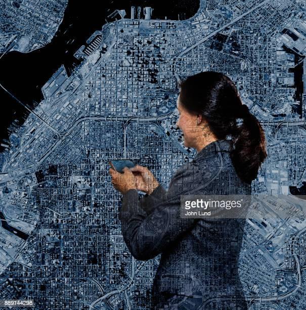 Woman Using GPS Double Exposure
