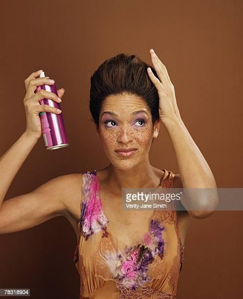 Woman using hairspray