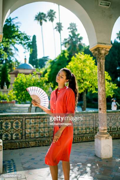 woman using hand fan. - hot spanish women stock pictures, royalty-free photos & images