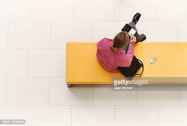 Woman Using Handheld Computer