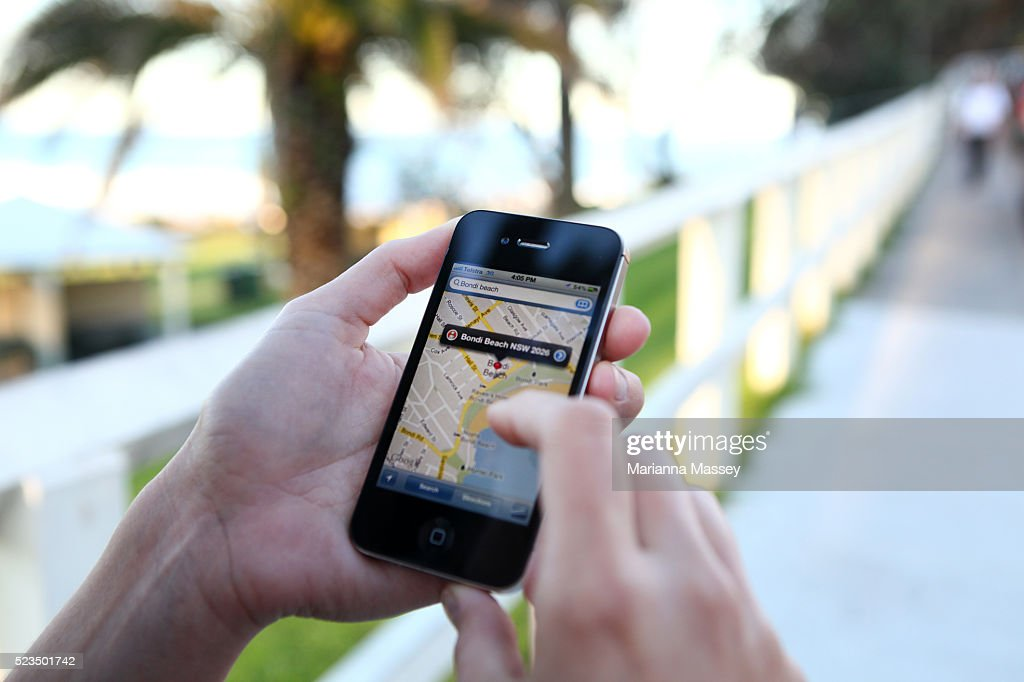 Woman Using Her iPhone : Stock Photo