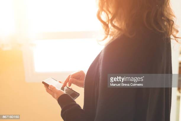 woman using her mobile phone - surfing the net stock photos and pictures