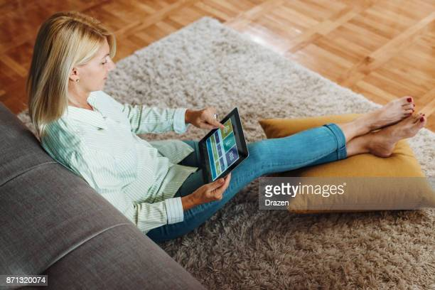 Woman using home automation app while resting
