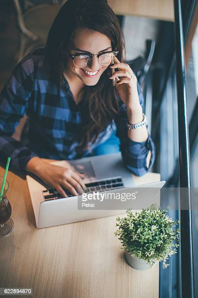 Woman using internet in a cafe