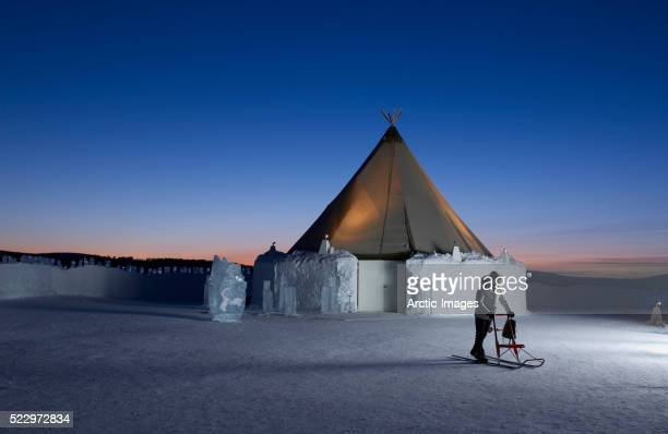 woman using kick sled at icehotel - ice hotel sweden stock pictures, royalty-free photos & images