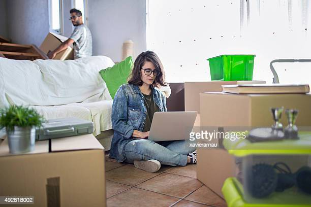 Woman using laptop at the new home