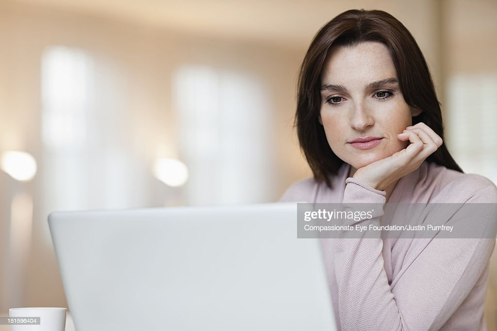 Woman using laptop, close up : Bildbanksbilder