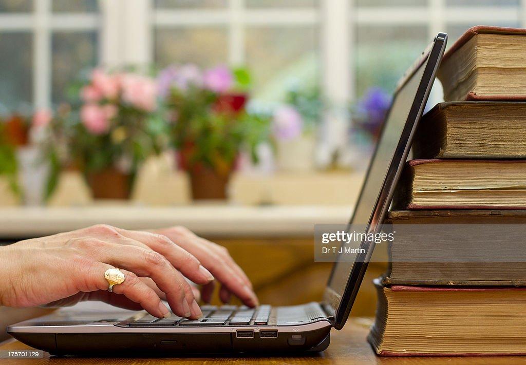 Woman using laptop computer : Stock Photo