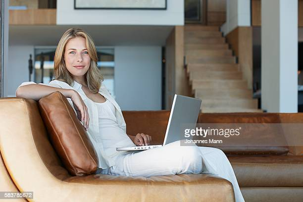 woman using laptop computer - prosperity stock pictures, royalty-free photos & images