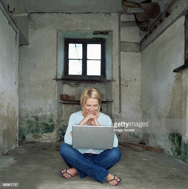 Woman using laptop in basement