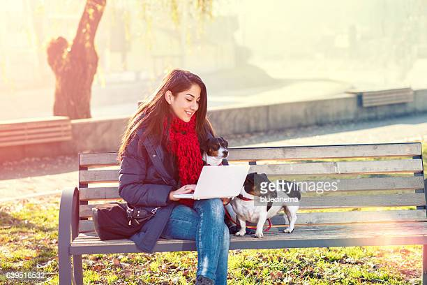 Woman using laptop outdoor.