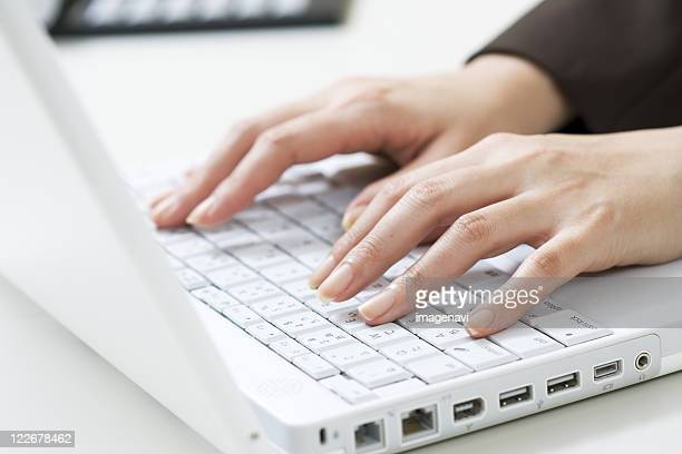 Woman Using Laptop