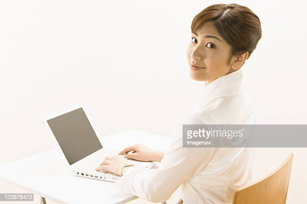 woman using laptop - birthing chair stock pictures, royalty-free photos & images