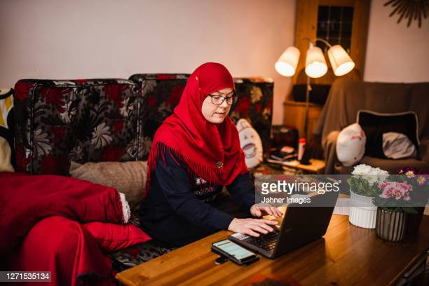 woman using laptop - västra götaland county stock pictures, royalty-free photos & images