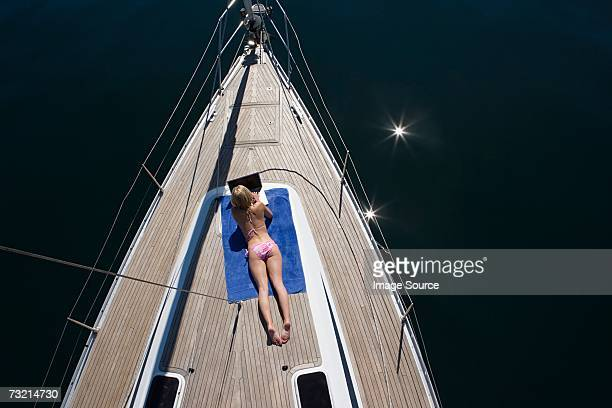 woman using laptop - boat deck stock pictures, royalty-free photos & images