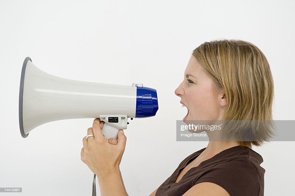 Woman using loudspeaker : Stock Photo