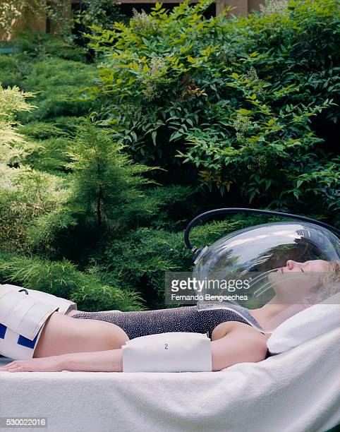 Woman Using Lymphatic Massage Cuffs While Receiving Oxygen Therapy