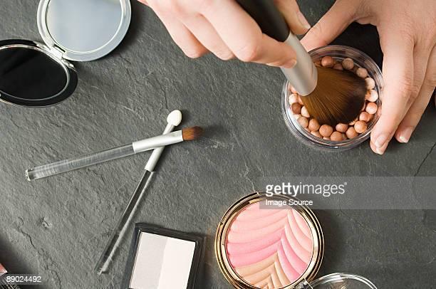 Woman using makeup