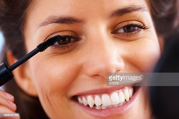 Woman using mascara