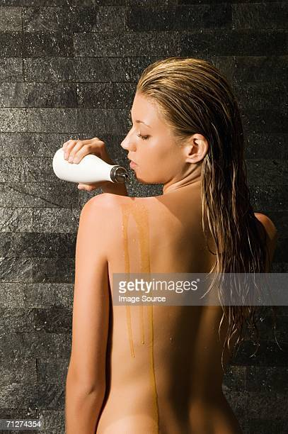 Woman using massage oil