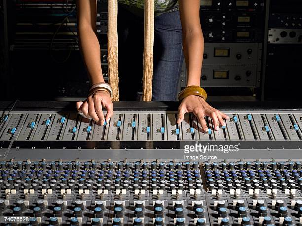 woman using mixing desk - equalizer stock pictures, royalty-free photos & images