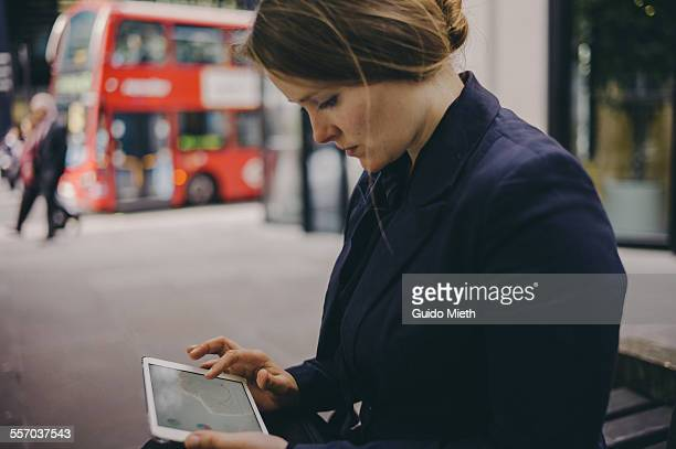 Woman using mobile device outdoor.