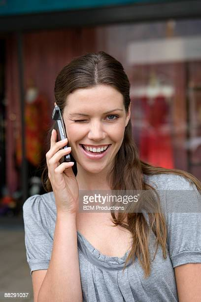 Woman using mobile phone in street