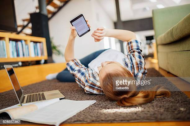 woman using mobile phone - bringing home the bacon stock photos and pictures