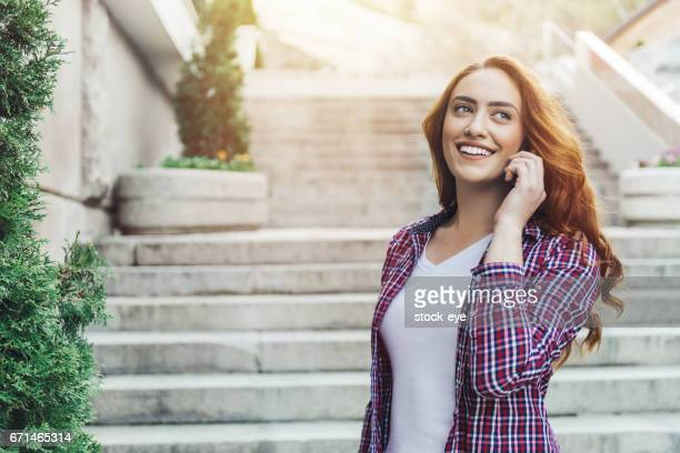 woman using mobile phone - happi stock photos and pictures