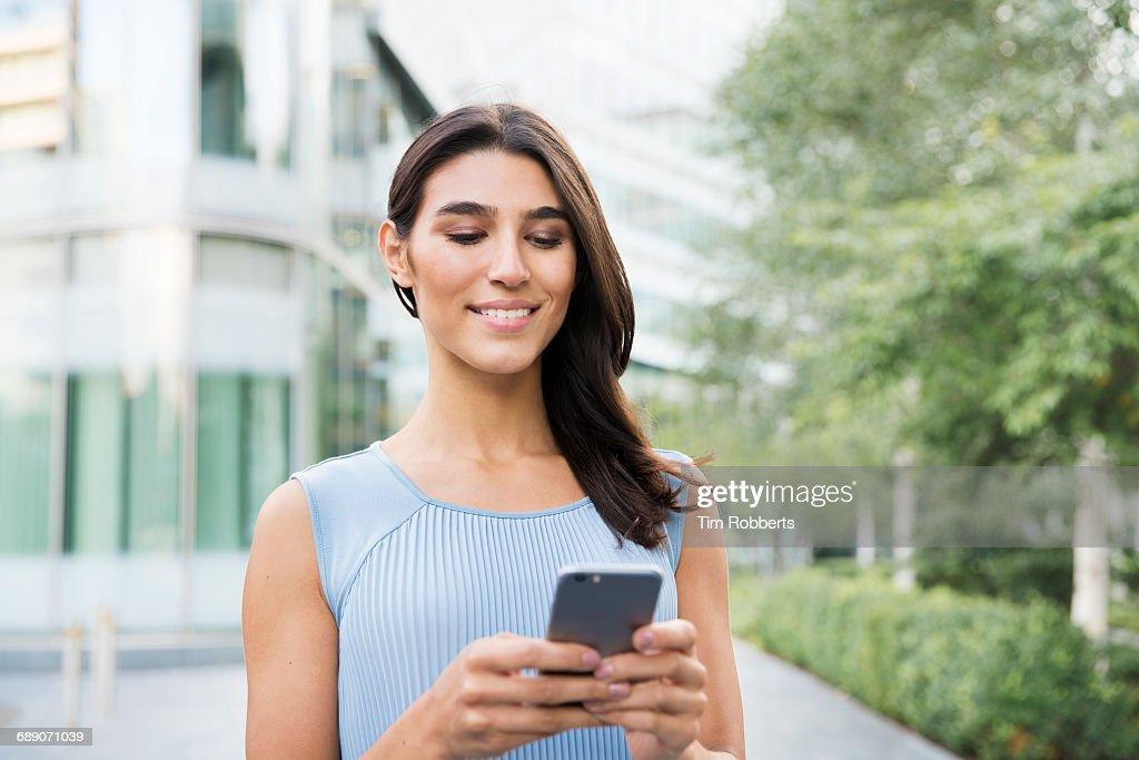 Woman using mobile phone : Stock Photo