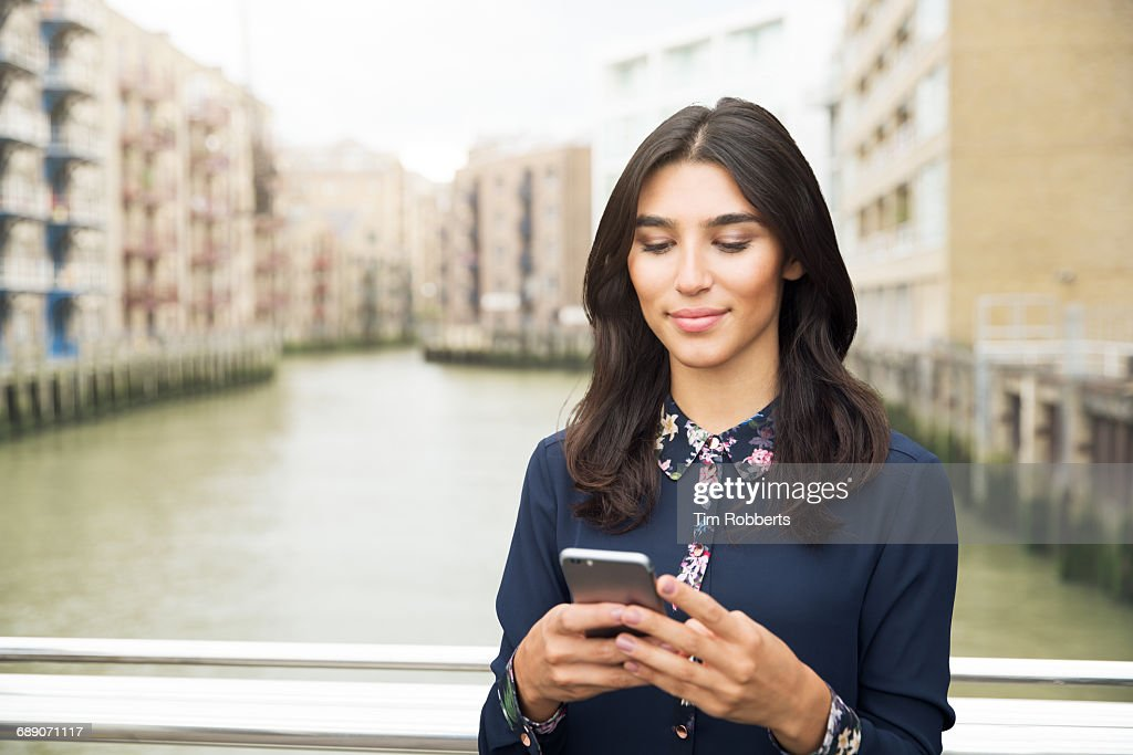 Woman using mobile phone : Stock Photo