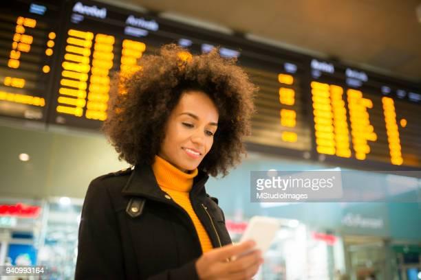 Woman using mobile phone.