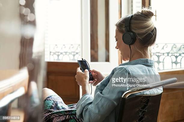 Woman using multimedia smartphone