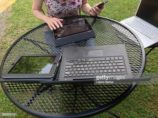Woman Using Multiple Wireless Devices