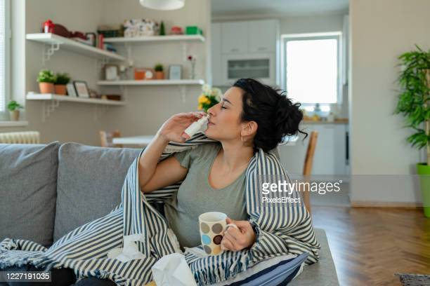 woman using nasal spray - condition stock pictures, royalty-free photos & images