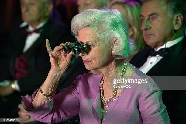 Woman Using Opera Glasses at the Theater
