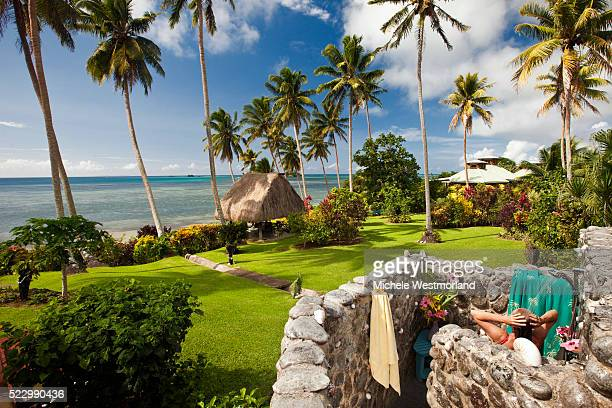 woman using outdoor shower in fiji - fiji stock pictures, royalty-free photos & images