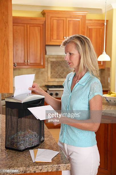 woman using paper shredder - shredded stock pictures, royalty-free photos & images