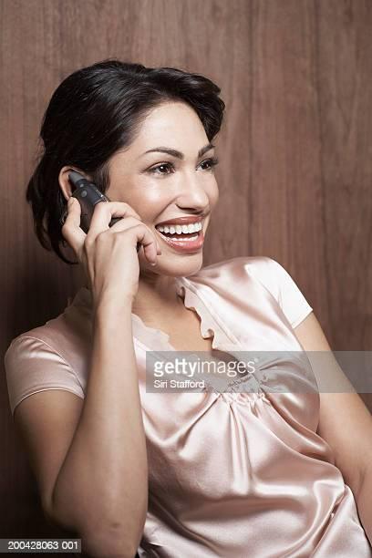 Woman using PDA phone
