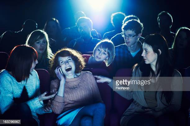 woman using phone during movie at cinema - public building stock pictures, royalty-free photos & images